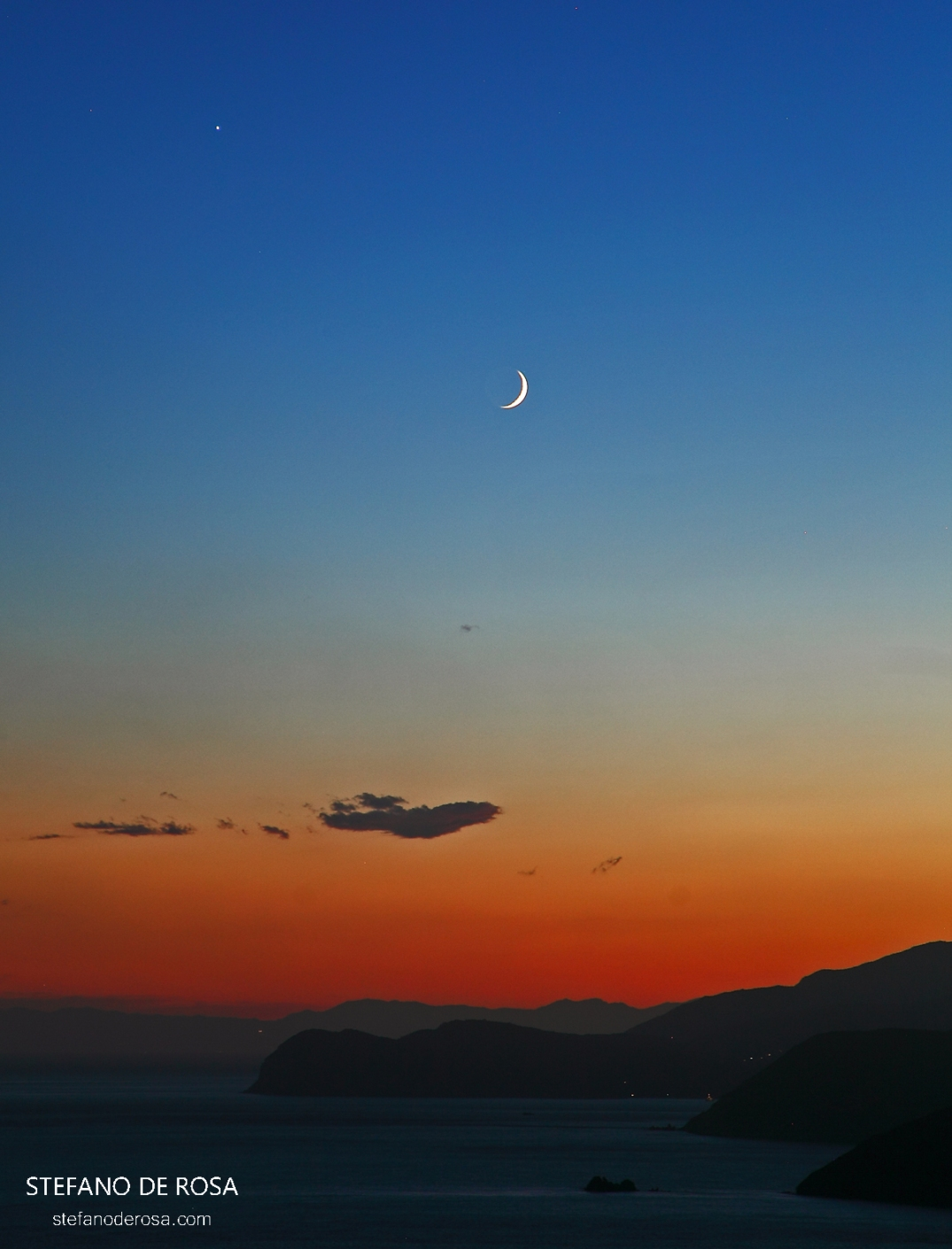 Moon and Jupiter over Isola d'Elba